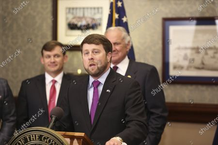 Stock Photo of Peter McCoy speaks at a news conference after South Carolina Gov. Henry McMaster, rear right, announced he wants to appoint him chairman of state-owned utility Santee Cooper, in Columbia, S.C. McCoy is a former South Carolina House member and U.S. Attorney in the state