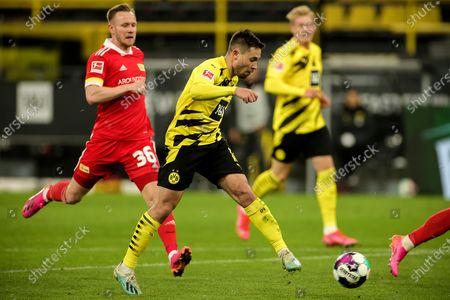 Dortmund's Raphael Guerreiro (C) scores the 2-0 lead during the German Bundesliga soccer match between Borussia Dortmund and 1. FC Union Berlin at Signal Iduna Park in Dortmund, Germany, 21 April 2021.
