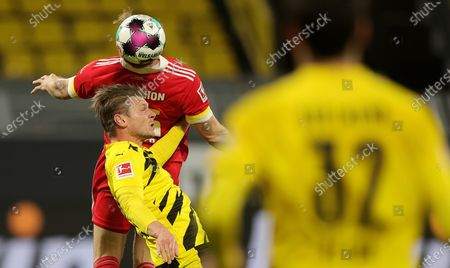 Union's Marius Buelter in action with Dortmund's Lukasz Piszczek during the German Bundesliga soccer match between Borussia Dortmund and 1. FC Union Berlin at Signal Iduna Park in Dortmund, Germany, 21 April 2021.