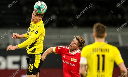 Dortmund's Lukasz Piszczek (L) and Union's Marius Buelter (C) in action during the German Bundesliga soccer match between Borussia Dortmund and 1. FC Union Berlin at Signal Iduna Park in Dortmund, Germany, 21 April 2021.
