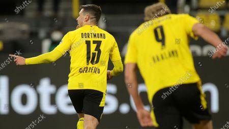 Dortmund's Raphael Guerreiro celebrates scoring his teams second goal during the German Bundesliga soccer match between Borussia Dortmund and 1. FC Union Berlin at Signal Iduna Park in Dortmund, Germany, 21 April 2021.