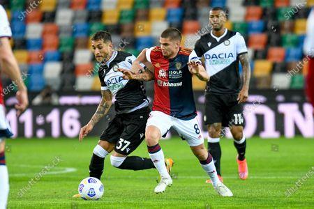 Roberto Pereyra (Udinese) in action against Razvan Marin (Cagliari)