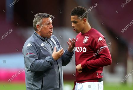 Aston Villa assistant manager Craig Shakespeare (L) talks with his player Jacob Ramsey (R) prior to the English Premier League soccer match between Aston Villa and Manchester City in Birmingham, Britain, 21 April 2021.