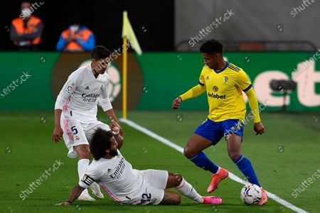 Cadiz's Anthony Lozano, right, vies for the ball with Real Madrid's Raphael Varane, left, and Marcelo during the Spanish La Liga soccer match between Cadiz and Real Madrid at the Ramon Carranza stadium in Cadiz, Spain