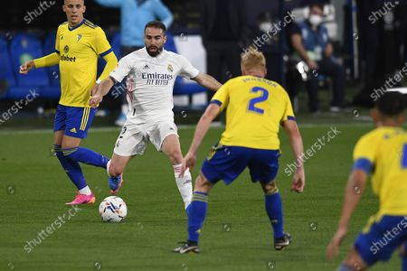 Real Madrid's Dani Carvajal, center, vies for the ball with Cadiz defenders during the Spanish La Liga soccer match between Cadiz and Real Madrid at the Ramon Carranza stadium in Cadiz, Spain, . Real Madrid won 3-0