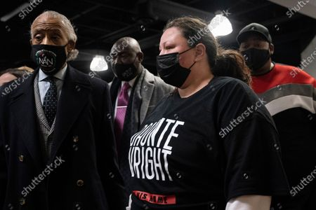 Katie Wright, mother of Daunte Wright, leaves Shiloh Temple International Ministries during her son's wake alongside Rev. Al Sharpton, left, and attorney Ben Crump, center left, in Minneapolis. The 20-year-old Wright was killed by then-Brooklyn Center police officer Kim Potter during a traffic stop