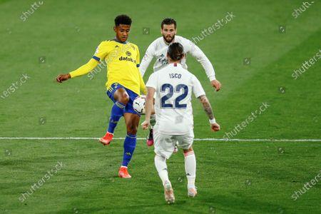 Anthony Lozano of Cadiz CF and Francisco Roman Alarcon Isco and Nacho Fernandez of Real Madrid