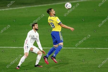 Alvaro Negredo of Cadiz CF and Raphael Varane of Real Madrid