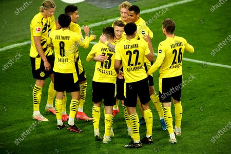 Dortmund's Raphael Guerreiro (front-C) celebrates with his teammates after scoring the 2-0 lead during the German Bundesliga soccer match between Borussia Dortmund and 1. FC Union Berlin at Signal Iduna Park in Dortmund, Germany, 21 April 2021.