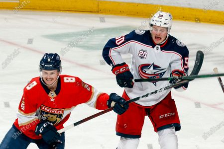 Florida Panthers defenseman Matt Kiersted (8) defends against Columbus Blue Jackets left wing Eric Robinson (50) during the third period of an NHL hockey game, in Sunrise, Fla