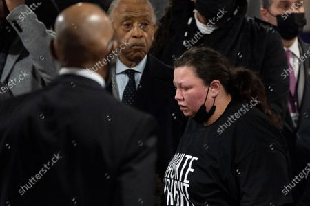 Katie Wright, right, mother of Daunte Wright, reacts beside Rev. Al Sharpton, center, during her son's wake, in Minneapolis. The 20-year-old Wright was killed by then-Brooklyn Center police officer Kim Potter during a traffic stop