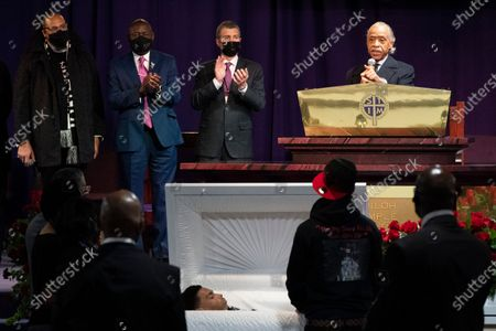 The Rev. Al Sharpton, right, speaks over the casket of Daunte Wright, alongside attorneys Antonio Romanucci, center, and Ben Crump, center left, and the Rev. Greg Drumwright, left, in Minneapolis. The 20-year-old Wright was killed by former Brooklyn Center police Officer Kim Potter during a traffic stop