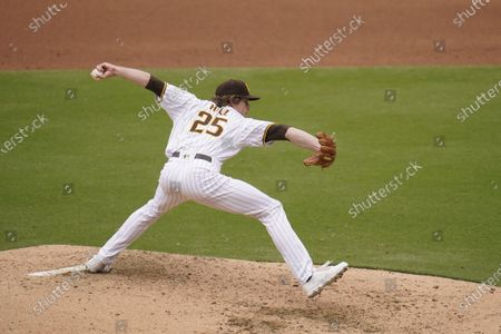 San Diego Padres pitcher Tim Hill works against a Milwaukee Brewers batter during the third inning of a baseball game, in San Diego