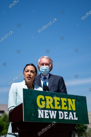 Rep. Alexandria Ocasio-Cortez (D-NY) and Sen. Ed Markey (D-MA) at a news conference to reintroduce the Green New Deal and introduce the Civilian Climate Corps Act at the Capitol Reflecting Pool near the West Front of the U.S. Capitol Building on Tuesday, April 20, 2021 in Washington, DC. (Kent Nishimura / Los Angeles Times)