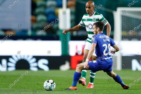 Sporting's player Joao Mario (R) in action against Afonso Sousa of Belenenses SAD during their Portuguese First League soccer match held at Alvalade Stadium in Lisbon, Portugal, 21 April 2021.