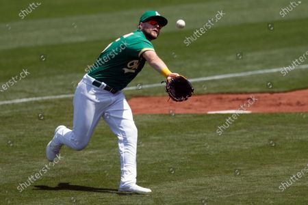 Oakland Athletics right fielder Seth Brown tries to catch a foul ball hit by Minnesota Twins Ryan Jeffers during the second inning of their MLB game at RingCentral Coliseum in Oakland, California, USA, 21 April 2021.