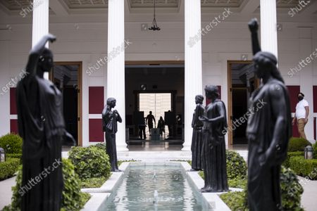 Visitors enter the J. Paul Getty Museum at the Getty Villa as it reopens its doors to the public after being closed due to the coronavirus pandemic, in Los Angeles, California, USA, 21 April 2021. The Getty Villa reopened with the temporary exhibition the exhibition 'Mesopotamia: Civilization Begins' running from April 21 to August 16, 2021.