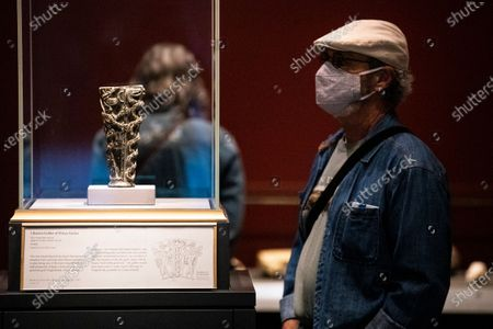 A visitor looks at the artwork 'Libation Goblet of Prince Gudea' in the exhibition 'Mesopotamia: Civilization Begins' at the J. Paul Getty Museum as the Getty Villa reopens to the public after being closed due to the coronavirus pandemic in Los Angeles, California, USA, 21 April 2021. The exhibition runs from April 21 to August 16, 2021.