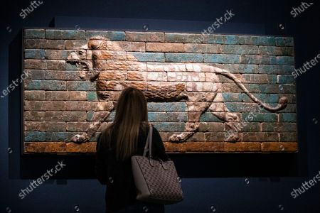 A visitor looks at a 'Wall Panel with a Striding Lion' in the exhibition 'Mesopotamia: Civilization Begins' at the J. Paul Getty Museum as the Getty Villa reopens to the public after being closed due to the coronavirus pandemic in Los Angeles, California, USA, 21 April 2021. The exhibition runs from April 21 to August 16, 2021.