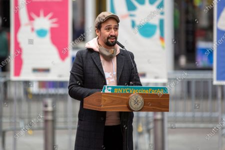 Actor Lin-Manuel Miranda speaks in Times Square in New York City, at the opening of a COVID-19 vaccination site for people who work on Broadway