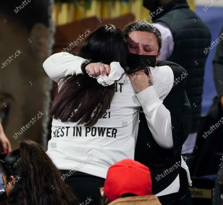 Katie Wright hugs a family member during a public viewing  for 20-year-old Daunte Wright in Brooklyn Center, Minnesota on Wednesday, April 21, 2021.  Wright was shot and killed by police officer Kimberly Ann Potter, who thought she was using a taser gun, during a recent traffic stop and attempted arrest.