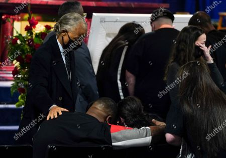 The Reverend Al Sharpton comforts Aubrey Wright and Katie Wright during a public viewing for 20-year-old Daunte Wright in Brooklyn Center, Minnesota on Wednesday, April 21, 2021.  Wright was shot and killed by police officer Kimberly Ann Potter, who thought she was using a taser gun, during a recent traffic stop and attempted arrest.