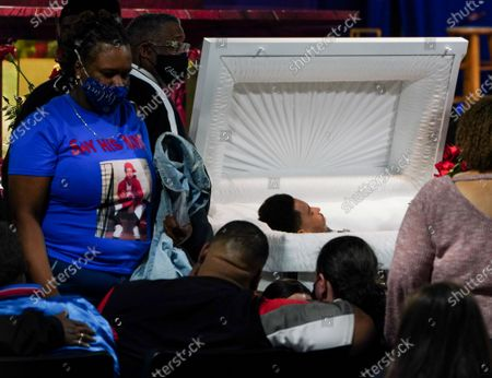 Aubrey Wright and Katie Wright view their son during a public viewing for 20-year-old Daunte Wright in Brooklyn Center, Minnesota on Wednesday, April 21, 2021.  Wright was shot and killed by police officer Kimberly Ann Potter, who thought she was using a taser gun, during a recent traffic stop and attempted arrest.