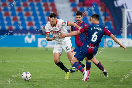 Oscar Esau Duarte of Levante UD and Lucas Ocampos of Sevilla FC are seen in action during the Spanish La Liga football match between Levante and Sevilla at Ciutat de Valencia stadium. (Final score; Levante UD 0:1 Sevilla FC)