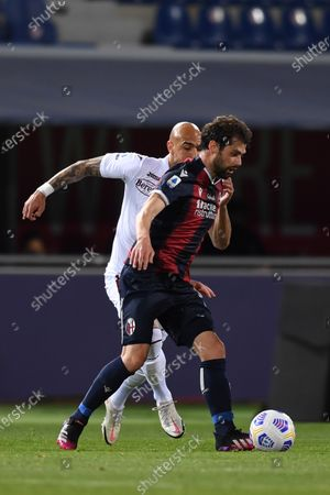 "Andrea Poli (Bologna)Simone Zaza (Torino)        during the Italian ""Serie A"" match between Bologna 1-1 Torino  at  Renato Dall Ara Stadium in Bologna , Italy."