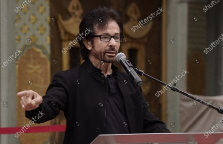 """Stock Photo of George Chakiris, a cast member in the 1961 film """"West Side Story,"""" is interviewed at an event to celebrate the classic Hollywood movie musical's 60th anniversary at the TCL Chinese Theatre, in Los Angeles"""