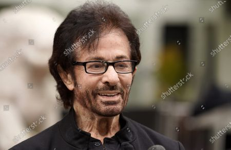 """George Chakiris, a cast member in the 1961 film """"West Side Story,"""" is interviewed at an event to celebrate the classic Hollywood movie musical's 60th anniversary at the TCL Chinese Theatre, in Los Angeles"""