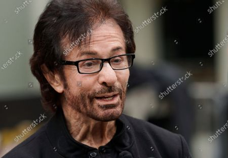 """Stock Picture of George Chakiris, a cast member in the 1961 film """"West Side Story,"""" is interviewed at an event to celebrate the classic Hollywood movie musical's 60th anniversary, at the TCL Chinese Theatre, in Los Angeles"""