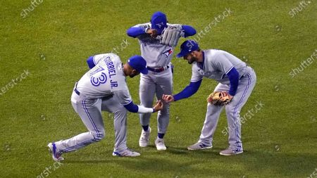 Toronto Blue Jays outfielders Lourdes Gurriel Jr., Jonathan Davis and Randal Grichuk, from left, celebrate after the Blue Jays defeated the Boston Red Sox 6-3 in a baseball game at Fenway Park, in Boston