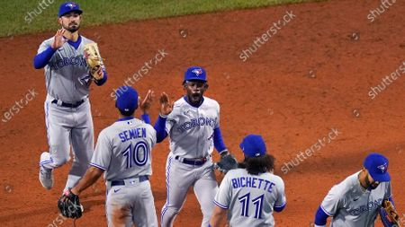 Toronto Blue Jays outfielder Jonathan Davis, celebrates with teammates after the Blue Jays defeated the Boston Red Sox 6-3 in a baseball game at Fenway Park, in Boston