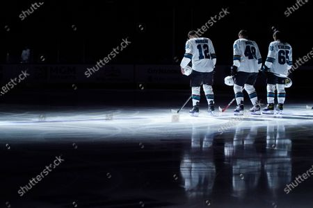 San Jose Sharks center Patrick Marleau, from left, Tomas Hertl and Erik Karlsson stand during the national anthem before an NHL hockey game against the Vegas Golden Knights, in Las Vegas