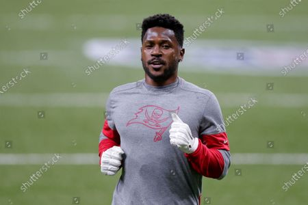 Tampa Bay Buccaneers wide receiver Antonio Brown warms up before the first half of an NFL divisional round playoff football game between the New Orleans Saints and the Tampa Bay Buccaneers in New Orleans. NFL wide receiver Antonio Brown has settled a civil lawsuit by former trainer Britney Taylor, who accused Brown of sexually assaulting her. Taylor filed the lawsuit in 2019, and lawyers for her and Brown released statements Wednesday, April 21, 2021 revealing the agreement