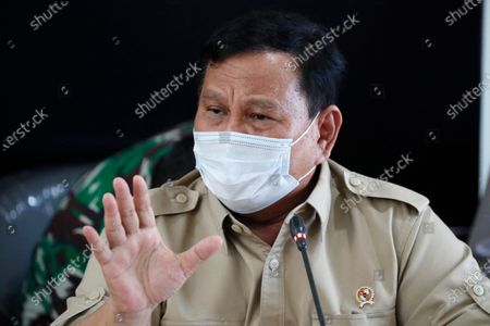 Stock Photo of Indonesian Defense Minister Prabowo Subianto speaks to the media during a press conference following a report of a missing Indonesian submarine, at Ngurah Rai Airport in Bali, Indonesia, 22 April 2021. An Indonesian submarine was reported missing on 21 April during a torpedo drill in waters north of Bali with 53 people on board.