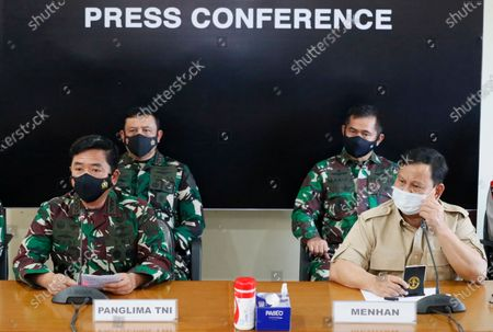 Indonesian Defense Minister Prabowo Subianto (R) and Indonesian military Chief Hadi Tjahjanto (L) speak to the media during a press conference following a report of a missing Indonesian submarine, at Ngurah Rai Airport in Bali, Indonesia, 22 April 2021. An Indonesian submarine was reported missing on 21 April during a torpedo drill in waters north of Bali with 53 people on board.