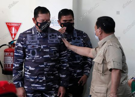 Indonesian Defense Minister Prabowo Subianto (R) talks to Chief of Staff of the Indonesian Navy Yudo Margono (L) after a press conference following a report of a missing Indonesian submarine, at Ngurah Rai Airport in Bali, Indonesia, 22 April 2021. An Indonesian submarine was reported missing on 21 April during a torpedo drill in waters north of Bali with 53 people on board.