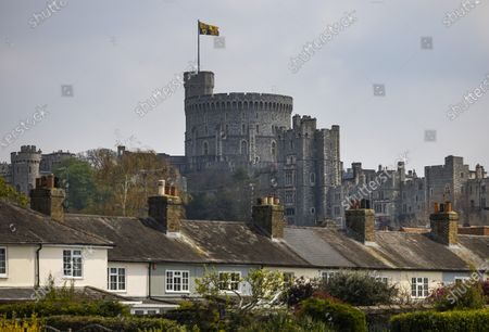 A large Royal Standard flies over Windsor Castle in Berkshire. Queen Elizabeth II is celebrating her 95th birthday today. Her Majesty is expected to have a low key celebration only four days after the funeral of the Duke of Edinburgh.