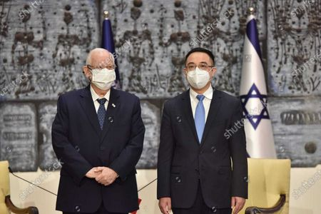 (210421) - JERUSALEM, April 21, 2021 (Xinhua) - Israeli President Reuven Rivlin (L) poses with the new Chinese Ambassador to Israel Cai Run during a credentials presentation at the president's residence in Jerusalem, on April 21, 2021. Rivlin said at Cai Run's credentials presentation ceremony on Wednesday that Israel is willing to make more efforts to further develop the Israel-China relationship.
