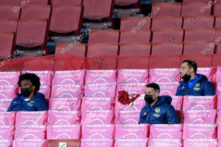 (L-R) Willian, Gabriel Martinelli and Cedric Soares of Arsenal in action during Premier League match between Arsenal and Everton at the Emirates Stadium in London - 23rd April 2021