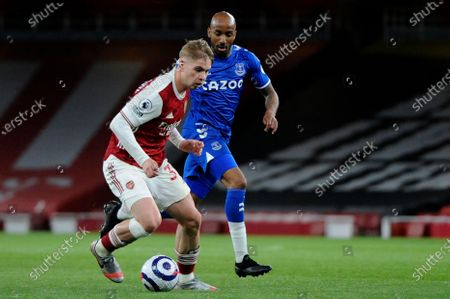 Emile Smith Rowe of Arsenal and Fabian Delph of Everton in action during Premier League match between Arsenal and Everton at the Emirates Stadium in London - 23rd April 2021