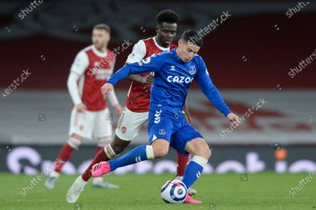 Bukayo Saka of Arsenal and James Rodriguez of Everton in action during Premier League match between Arsenal and Everton at the Emirates Stadium in London - 23rd April 2021
