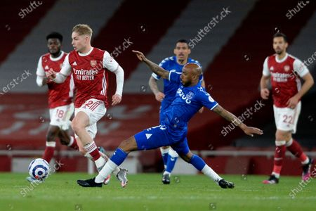 Stock Image of Emile Smith Rowe of Arsenal and Fabian Delph of Everton in action during Premier League match between Arsenal and Everton at the Emirates Stadium in London - 23rd April 2021