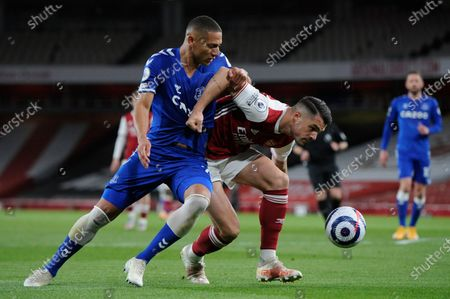 Granit Xhaka of Arsenal is fouled by Richarlison of Everton during Premier League match between Arsenal and Everton at the Emirates Stadium in London - 23rd April 2021