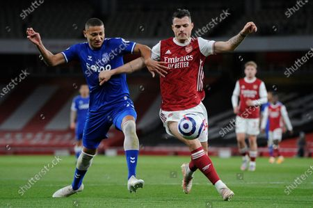 Granit Xhaka of Arsenal and Richarlison of Everton in action during Premier League match between Arsenal and Everton at the Emirates Stadium in London - 23rd April 2021