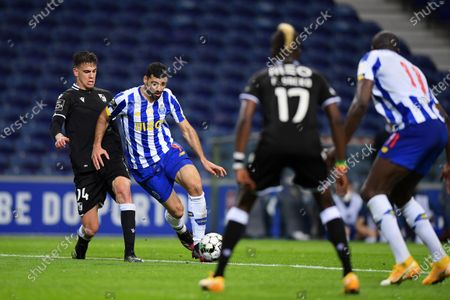 Mehdi Taremi of FC Porto and Jorge Fernandes of Vitoria de Guimaraes; Dragao Stadium, Porto, Portugal; Portuguese Championship 2020/2021, FC Porto versus Vitoria de Guimaraes.
