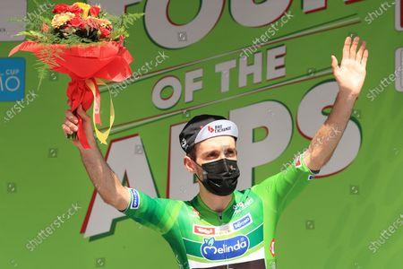 Stock Image of Simon Yates Team BikeExchange celebrates the tour leader position on the podium; Cycling Tour des Alpes Stage 5, Valle del Chiese to Riva del Garda, Italy on 23rd.