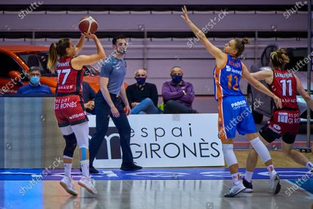 Stock Photo of Paola Ferrari of Spar Girona and Laura Juskaite of Valencia Basket in action during match one of Semifinals of the Womens League Spain Basketball between Spar Girona and Valencia Basket at Fontajau Pavilion on April 21, 2021 in Girona, Spain.